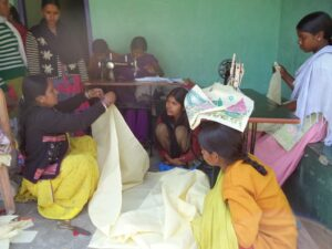 Students sowing at the KIRF Sewing Center