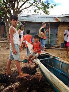 Young boys play by a boat that was damaged by Typhoon Haiyan (Yolanda) on Panay Island. Photo: Mark Kirwin