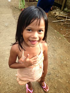 A little girl with a big smile who survived Typhoon Haiyan on the north east coast of Panay Island. Photo: Mark Kirwin
