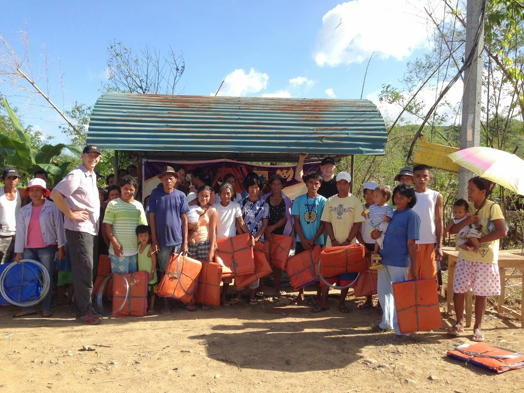 Families who got temporary roofs from KIRF in barangay San Diego. We wish we could of helped more families rebuild. Photo: Mark Kirwin