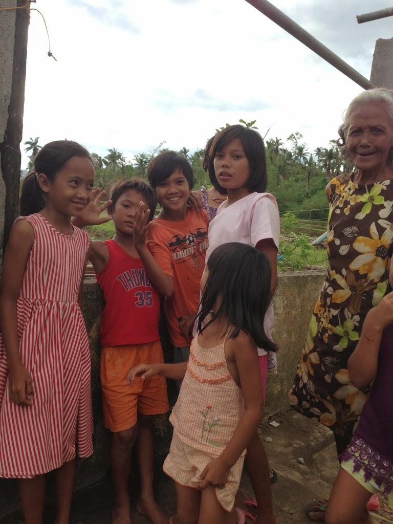 Children of barangay Borongon looking at us who are looking at them. Photo: Mark Kirwin