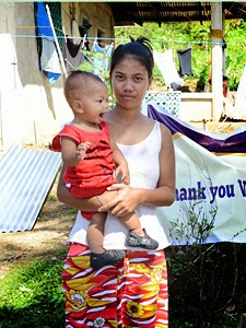 Happy baby, happy mama in barangay Borongon. Photo: Courtesy of Dr. Ted Robles