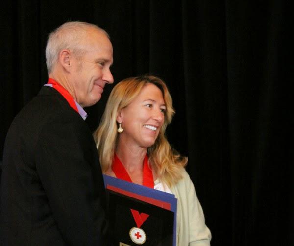 Mark and Angela Kirwin receiving the Red Cross Hero and Good Samaritan awards on behalf of KIRF and its disaster relief volunteers.