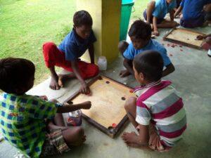 Children in The Shekhwara Village School playing a game