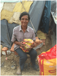 Picture of a woman holding aid supplies