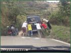 Villagers pushing car