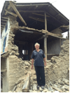 More damage with a picture of man in front of earthquake aftermath