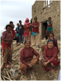 Picture of villagers in front of damage from earthquake.