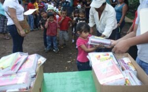 KIRF, and volunteers organizing by the medical clinic, passing out study materials that were purchased locally and distributed directly to the students just before the beginning of the Spring semester in January of 2016