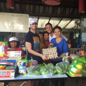 Our delivery of requested foods re-stocked the school's pantry was received with gratitude. Left to right: Ronin, Kyle, Noah, Noi, Kai and a school counselor.