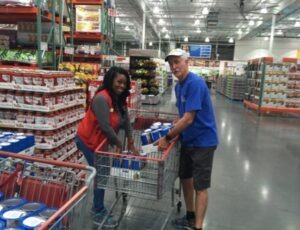 Steve lining up the shopping carts with supplies requested by families who lost their homes. Photo: Mark Kirwin