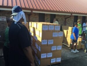 """Father Clark and his congregation delivered supplies to 30 elderly couples whose homes and contents were badly damaged by the flood waters."""")"""