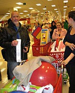 Kirwins met up with volunteers for the a local Target and Best Buy to purchase wish list items for the Homeless Children's Playtime Project non-profit that serves homeless children at several Washington, DC transitional living shelters. Image shows mark with volunteers in front of carts